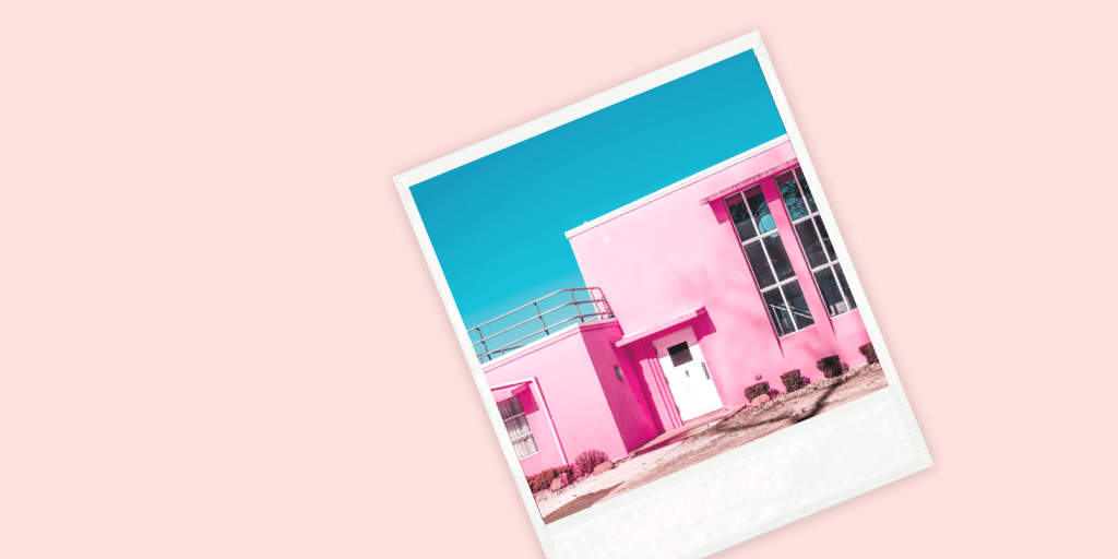 Stock Photo Polaroid of a pink building on a solid background