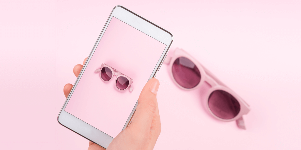 How to Take Product Photos With an Iphone At Home - iPhone taking photo of sunglasses on a pink background