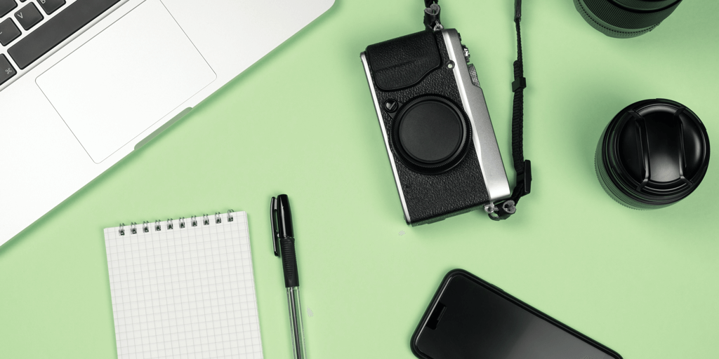 how to get sponsored on instagram header image - camera and computer on green flat lay